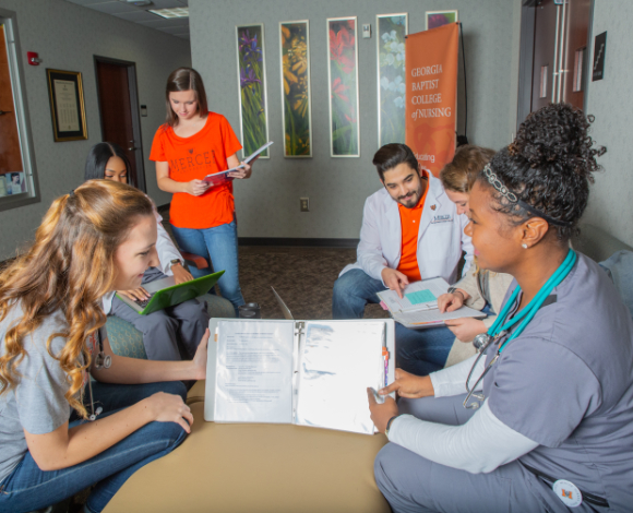 five students gather in a circle to study